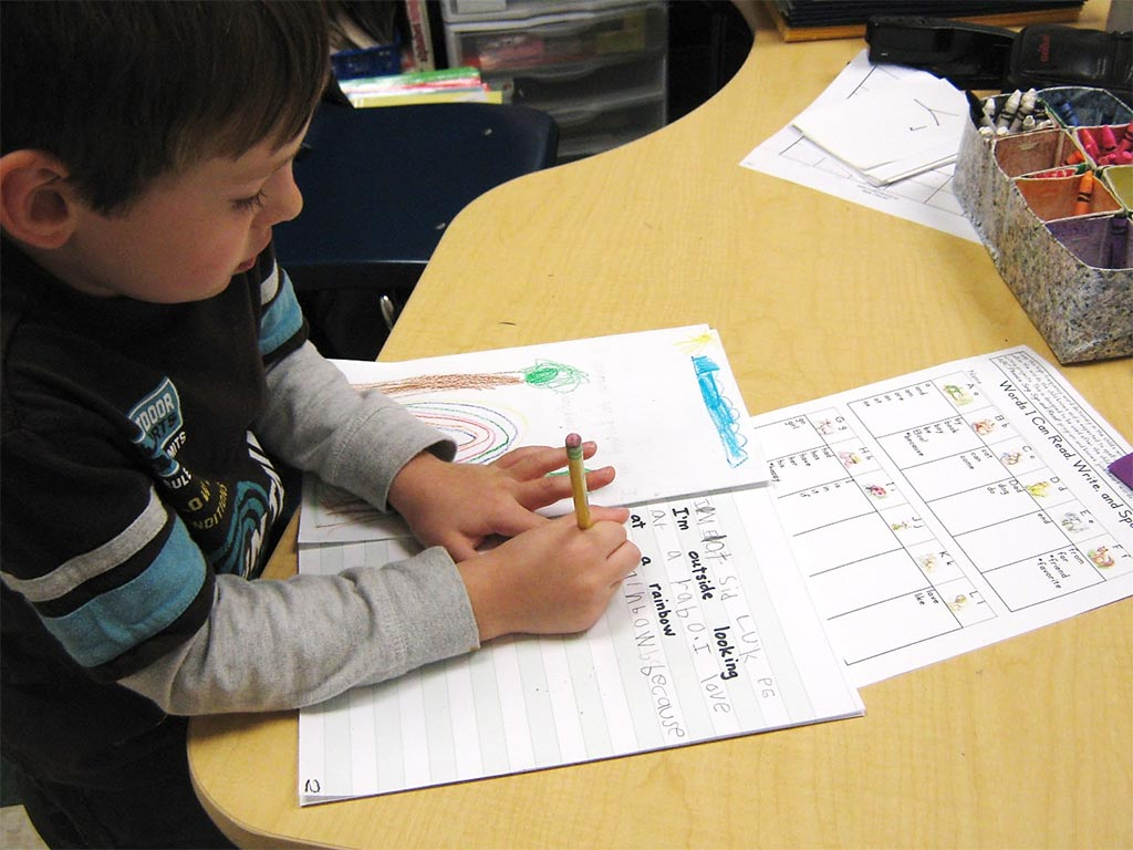 """During Writing Workshop children use the dictionary pages to remember how to spell high-frequency """"heart words""""."""