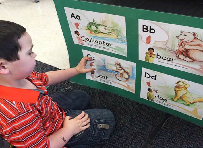 Teach children to sing, sign, fingerspell