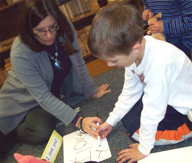 teacher coach children on efficient motions for letters